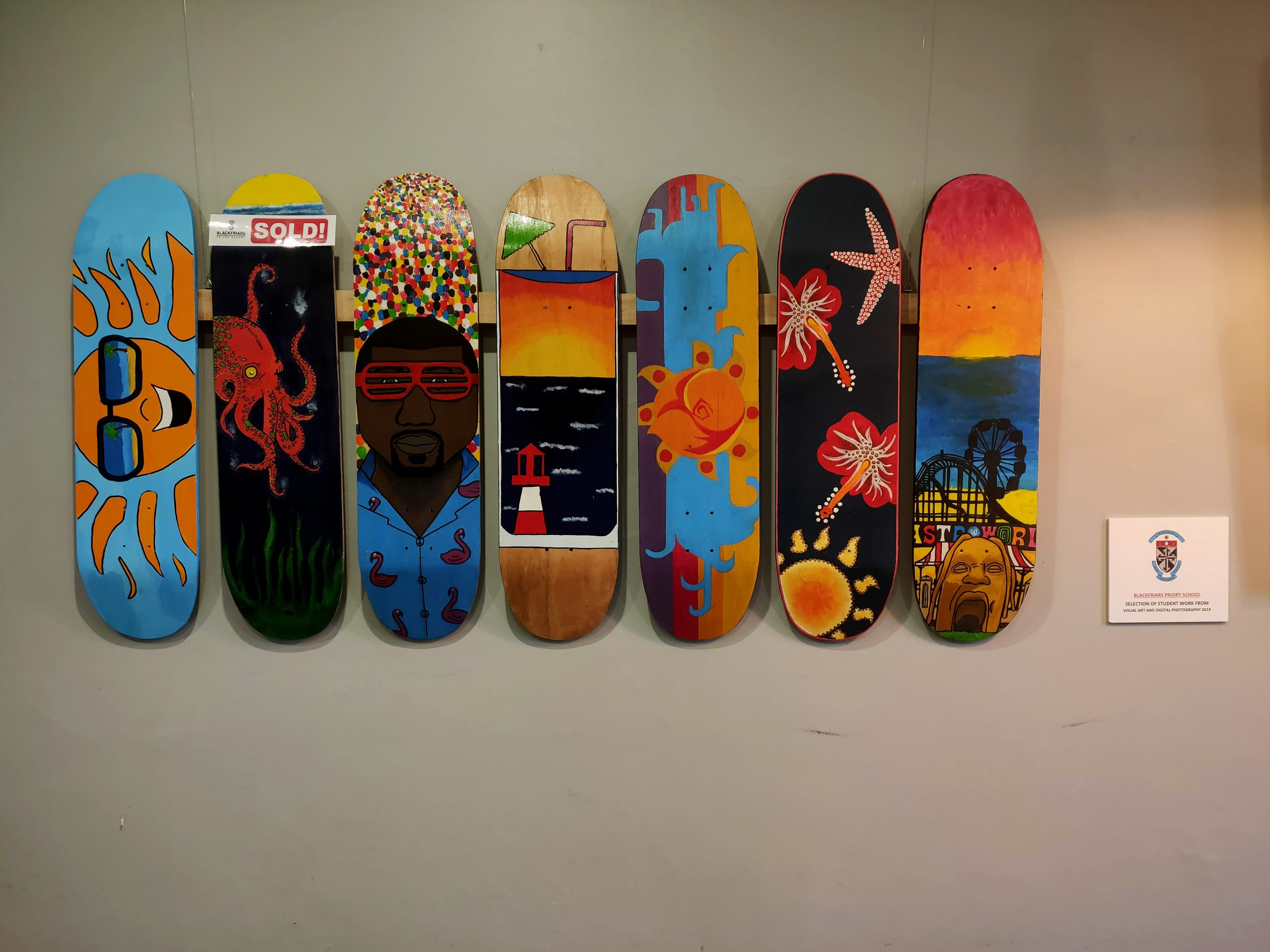 Painted skateboards on display at Cibo Prospect